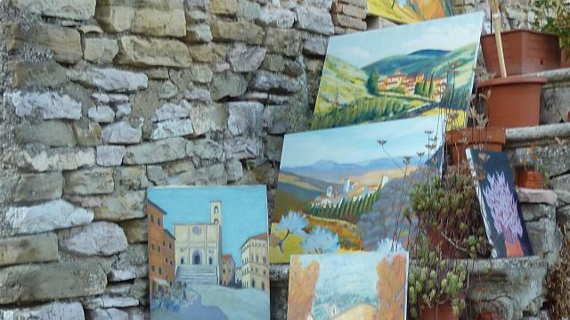 Paintings of villages and breathtaking Umbrian shown during an event